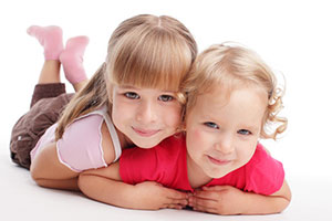 two young girls, smiling