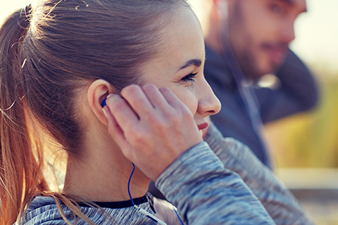 smiling girl listening to earbuds